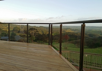 Edge Semi Frameless glass balustrade with matching top handrail as per new balustrade regulations