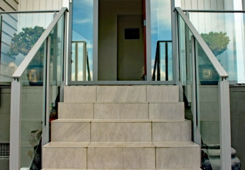 Front door on modern home with Edge semi frameless glass balustrade lr